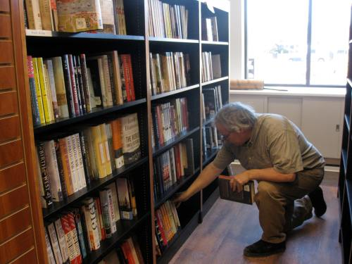 We are beginning to shelve. Here Bob S is hard at work.